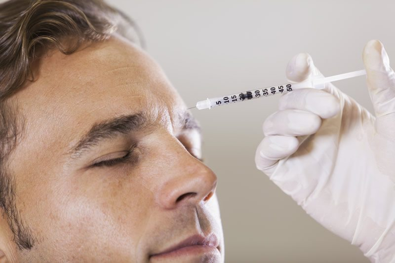 Man getting Botox Treatment for frown lines