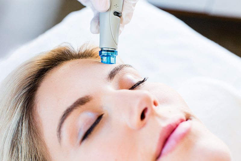 Woman getting a Hydrafacial MD Treatment