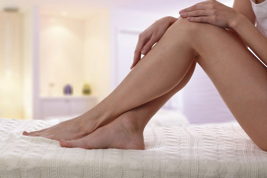 Woman's smooth legs after laser hair removal