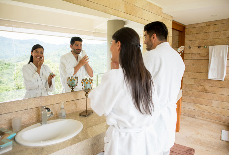 Couple Doing Morning Skincare While on Vacation