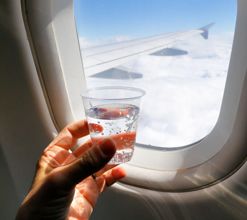 Drinking Water While Traveling on Airplane