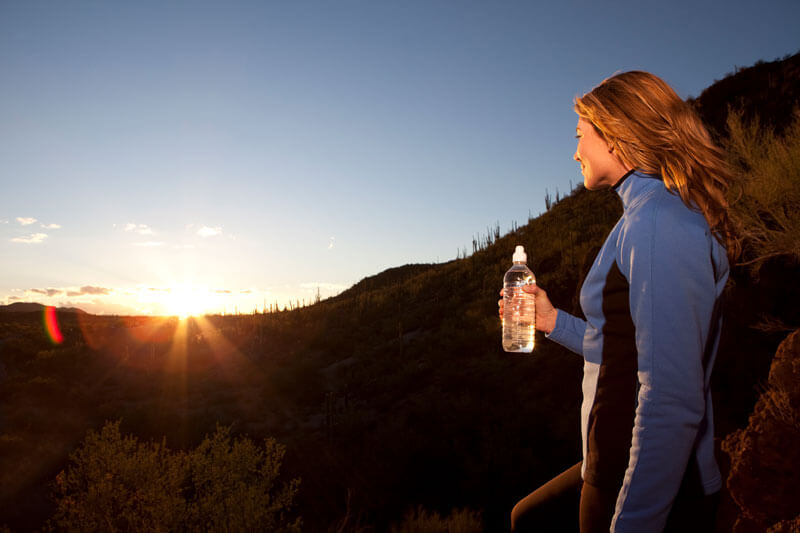 Women with Water Bottle to Stay Hydrated
