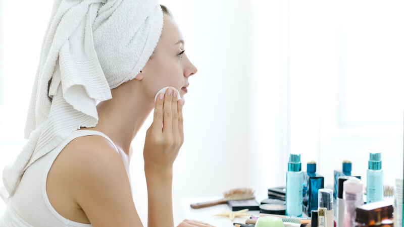 Woman Gently Removing Makeup
