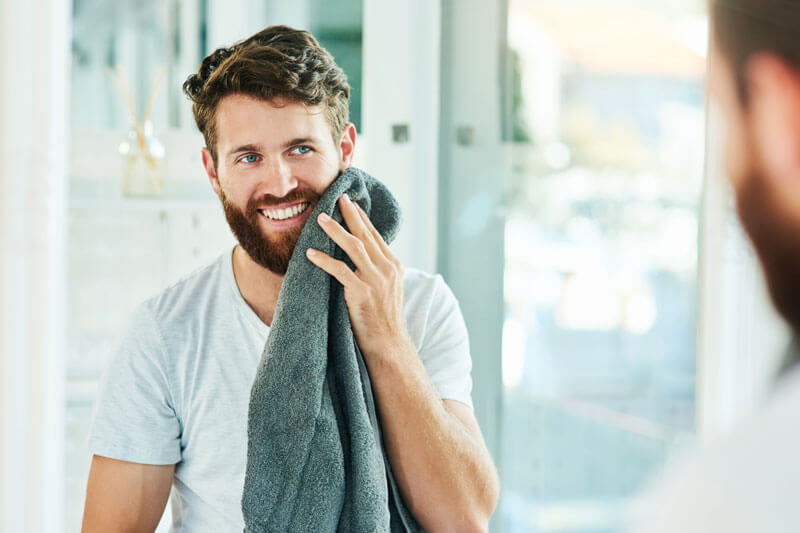 Man Drying his Face and Beard