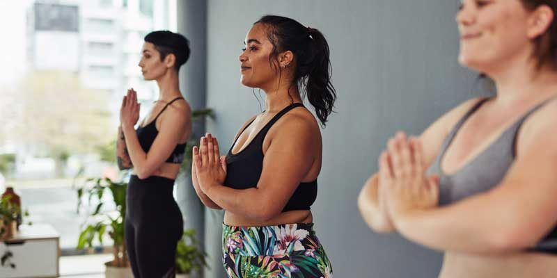 Three young women meditating during a yoga class, meditation-changes-your-body